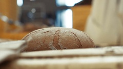 Close up of baking hot rye bread Stock Footage