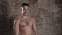 Handsome mature male model standing topless and flirt with camera Stock Footage