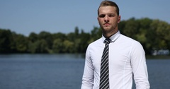 Young Business Person Looking Camera Presentation Corporate Man Park Lake Water Stock Footage
