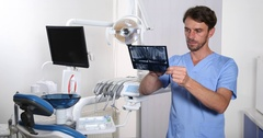 Caucasian Dentist Man Exam Radiography Examine Tooth Treatment Dental Cabinet Stock Footage