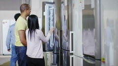 4K Couple shopping in a store selling kitchen appliances Stock Footage