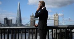 Banker Businessman Talking Mobile Phone Partner Connection London Skyline Tower Stock Footage