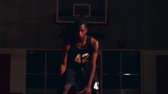 A basketball player on the court dribbling toward the camera Stock Footage
