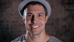Handsome mature man smiling with perfect white teeth with hat, happy portrait Stock Footage