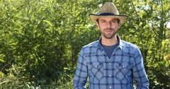 Optimistic Farmer Man Hold Fresh Carrots Look Camera Talking Organic Vegetables Stock Footage