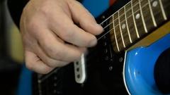Guitarist plays electric guitar. Close-up Stock Footage