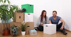 Attractive Mixed Race Couple Unpacking Modern Lamp Moving New Home Living Room Stock Footage