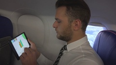 Attractive Businessman Analyzing Pie Chart Using Digital Tablet Aircraft Travel Stock Footage