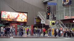 Red light turns green Hollywood Boulevard Walk of Fame people crossing street LA Stock Footage
