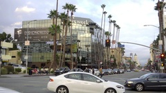 Cars driving on two way street on La Brea and Hollywood Boulevard in LA Stock Footage