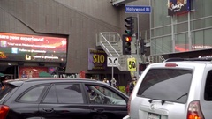 Cars and double decker tour bus driving in traffic on Hollywood Boulevard LA Stock Footage