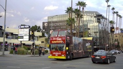 StarLine City Sightseeing tour bus turning corner Le Brea Hollywood Blvd LA Stock Footage