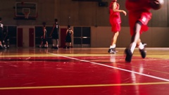 Low angle of basketball players warming up before a game Arkistovideo