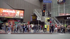 People and tourists walking on crowded busy Hollywood Boulevard Walk of Fame LA Stock Footage