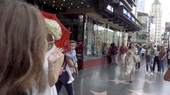 Marilyn Monroe impersonator waving and smiling at people on Hollywood Blvd LA Stock Footage