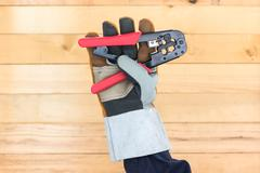 Hand in glove hold wire stripper Stock Photos