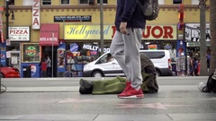Itchy homeless man scratching himself sitting on street Hollywood Boulevard LA Stock Footage