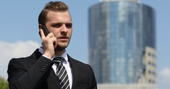 Young Businessperson Talk Mobile Phone Collaboration Communication City Center Stock Footage