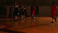 A basketball player misses a pass and the other team steals the ball Stock Footage
