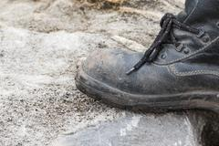 Trekking leather boot on the rock Stock Photos