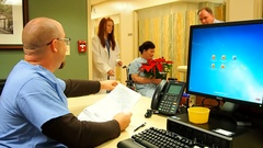 Hospital scene at nurses station Stock Footage