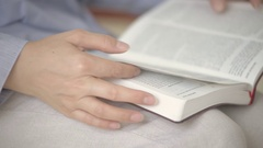 Close up view of woman reading a Bible Stock Footage
