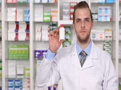 Pharmacist Man Showing Pills Plastic Bottle Hand Gestures Thumb Up Sign Pharmacy Stock Footage