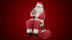 Santa Claus using tablet computer to surf internet and communicate in social Stock Footage