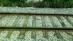 Track on a railway or railroad consisting of the rails, fasteners, railroad ties Stock Footage