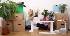 Young Couple Sit New Home Apartment Floor Disassembling Wood Pieces Furniture Stock Footage