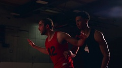 A basketball player being closely defended and then making a basket Stock Footage