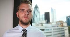 Confident Good Look Business Man Show Euro Bills to Camera London Skyline Center Stock Footage