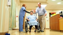 Nurse doctor and patient in wheelchair Stock Footage