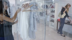4K Male & female customers shopping in fashionable boutique clothing store Stock Footage