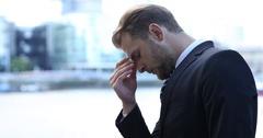 Portrait of Upset Business Man Headache Pain Brexit Crisis London Skyline City Stock Footage