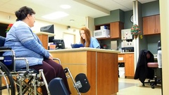 Female nurse taking patient inofrmation Stock Footage