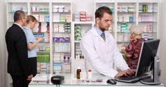 Pharmacist Man Working Computer Patient Customers People Pharmacy Store Activity Stock Footage