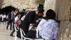 An Orthodox Jew Praying with Passion at the Western Wall in Jerusalem Stock Footage