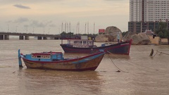 Vietnamese boats on a river at sunset Stock Footage