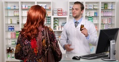 Pharmacist Man Show Medicine Bottle Recommend Explaining Patient Pharmacy Store Stock Footage