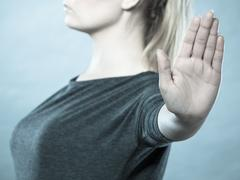 Assertive woman making stop gesture. Stock Photos