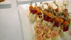 A variety of snacks on white table Stock Footage