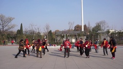 Chinese Dama are dancing waist drum in a park square on a morning Stock Footage