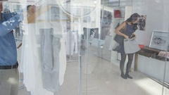 4K Male sales assistant helping female customer in fashion clothing store Stock Footage