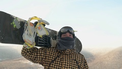Snowboarder on top of the mountain Stock Footage