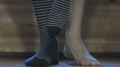 The man wears striped socks Stock Footage