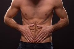 Abs low fat young man stomach crease wrinkles Stock Photos