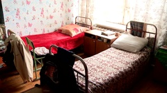 Beds in a homeless shelter in Russia Stock Footage