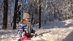 4K Child Playing in Snow, Winter View, Girl Making a Snowman in Park, Children Stock Footage
