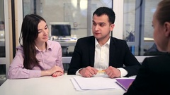 Happy couple signing real-estate contract Stock Footage